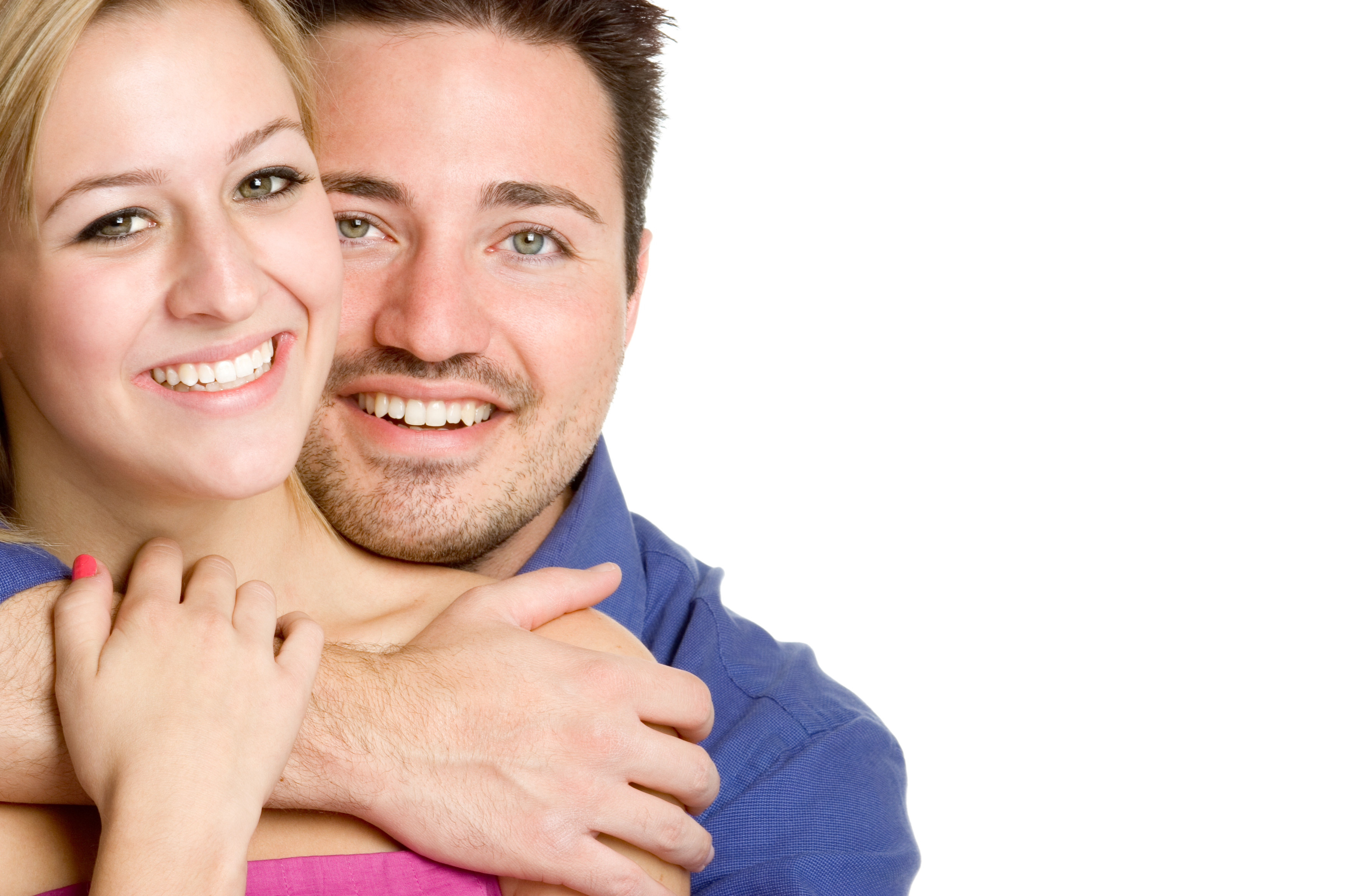 Happy young white couple in loving embrace